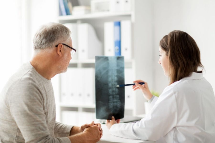 Doctor with Spine Patient